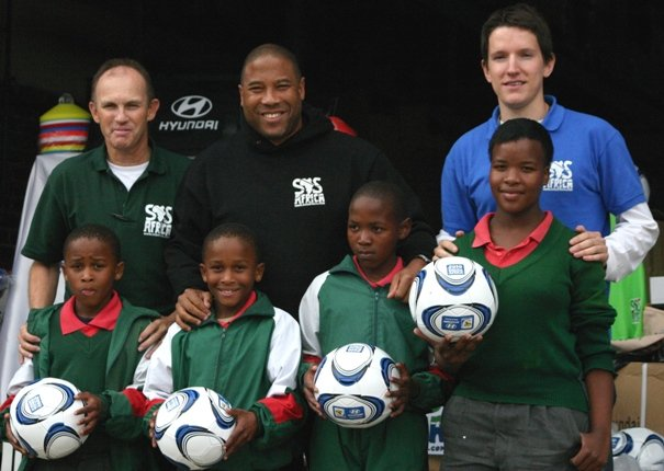 John Barnes presents footballs to the SOS Africa children