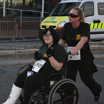 Kelly and Tania completing the Cardiff Half Marathon 2013