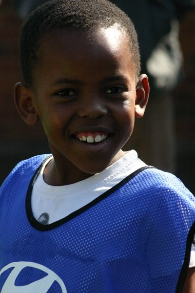 A young boy supported by the SOS Africa / Hyundai 2010 South Africa Football World Cup Charity Project