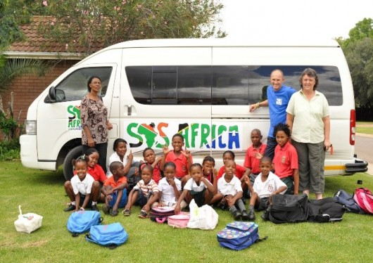 SOS kids celebrate charity's 9th birthday with a ride to school in style