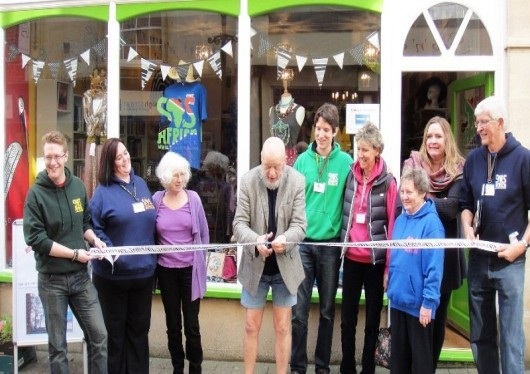 Glastonbury Festival's Michael Eavis Declares the New SOS Africa Charity Shop Open for Business