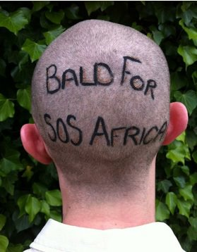 School teacher lets students shave his head for SOS Africa