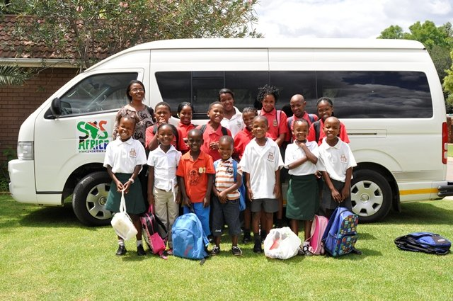 The SOS Africa Charity children with their new school bus