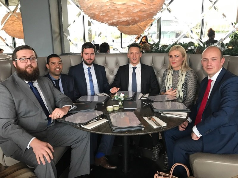 Cover and Legal Ceo Jay Mychalkiw with his team