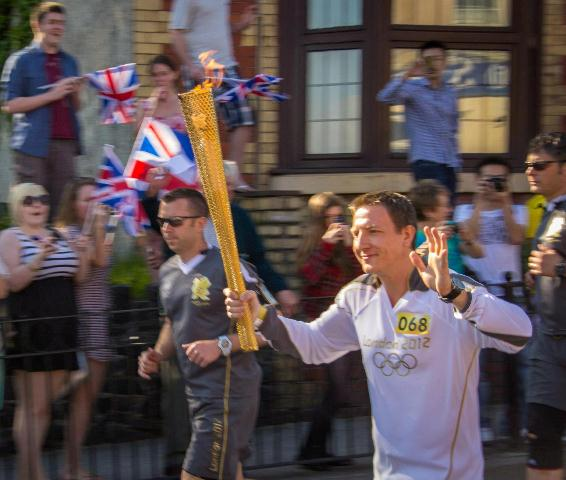 Matthew carrying the Olympic Flame for SOS Africa