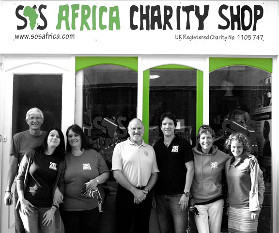 The SOS Africa Charity staff and volunteers alongside Marcus Wyburn-Mason